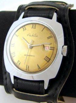 Ruhla GDR Herrenuhr Handaufzug Datum silber gold braun DDR Unterlagenband