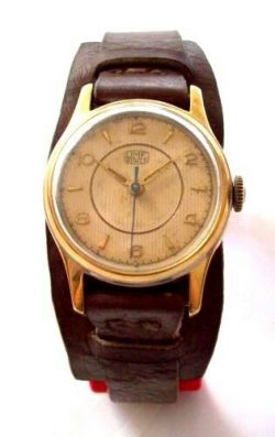 UMF Ruhla mechanische DDR Herrenuhr Handaufzug braun gold Unterlagen Uhrband GDR