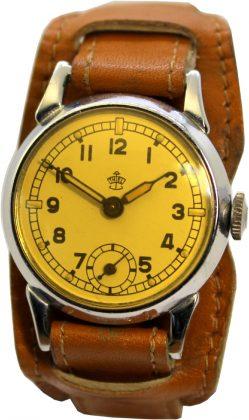 Thiel vintage Herrenuhr klein 31mm Handaufzug original farbiges Glas gelb vintage Unterlagenband braun
