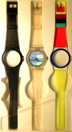 Fortis Container Werbeuhr unisex mit farbigen Wechselbändern swiss made 33,5mm NOS mit Lagerspuren